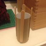 I glued my sticks. Space sticks equally around the cylinder and 25mm above the cylinder.