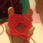 When back to the beginning, take the bottom yarn and place over the top yarn.