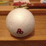 Push pin in to foam ball.