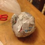 Fill plastic bag with newspaper.