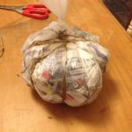 Tie string around bag to give shape.